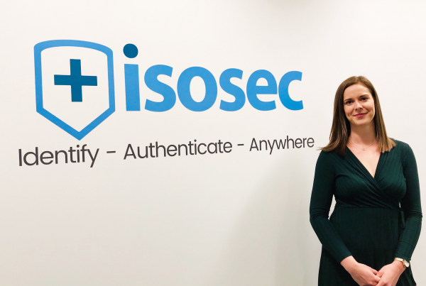 Claire Thorpe in front of Isosec Logo